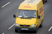 DHL parcel delivery van, M4 motorway, Bristol. - Paul Box - 2000s,2007,cargo,cities,city,company,courier,COURIERS,deliveries,DELIVERING,delivery,driver,drivers,driving,EBF Economy,freight,highway,home,international,job,jobs,LAB LBR work,motorway,MOTORWAYS,parc