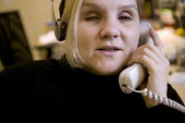 A visually impaired employee at work, in an office. - Paul Box - 2000s,2005,access,Accessibility,Adapting,and,attention,attentive,BCAB,blind,blindness,call,calls,communicating,communication,Communications,COMPUTE,COMPUTER,COMPUTERS,COMPUTING,conversation,conversati