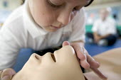 Pupils taking part in an afterschool class in First Aid from St Josephs RC Primary, Tredegar, Gwent. - Paul Box - ,2000s,2005,ABC,activities,activity,afternoon,afterschool,airway,airways,and,Anne,Annie,breathing,Cardiopulmonary,child,CHILDHOOD,children,circulation,club,clubs,Course,Courses,CPR,dummies,dummy,edu e