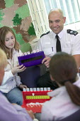 A community project to reduce crime in a urban area, located at an after-school club in the Winchestown Family Centre. Police and police community support officers in the centre engage with young peop... - Paul Box - 05-04-2006