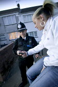 A community project to reduce crime in a urban area, located at the Winchestown Family Centre. Police officers in the centre engage with young people from the local area. - Paul Box - 2000s,2006,adolescence,adolescent,adolescents,adult,adults,anti social behaviour,area,beat,behavior,behaviour,CELLULAR,centre,Centres,CLJ,communicating,communication,communities,community,conversation