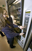 A new vending machine system that by allowing pupils to put money onto a key; stops them from carrying money around school. It also stocks healthy food and keeps a record of the time tand what they ha... - Paul Box - 2000s,2006,adolescence,adolescent,adolescents,automated,AUTOMATIC,automation,break,buy,buyer,buyers,buying,carries,carry,carrying,cashless,child,CHILDHOOD,children,choice,choosing,commodities,commodit