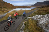 Mountain biking in Arkle, Cape Wrath, Scotland. - Paul Box - 2000s,2005,backpack,backpacks,bag,bags,bicycle,bicycles,BICYCLING,Bicyclist,Bicyclists,bike,bikes,biking,Biking Trail,cape,country,countryside,cycle,cycles,cycling,cyclist,cyclists,friend,friends,frie