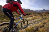 Mountain biking in Arkle, Cape Wrath, Scotland. - Paul Box - 2000s,2005,backpack,backpacks,bag,bags,bicycle,bicycles,BICYCLING,Bicyclist,Bicyclists,bike,bikes,biking,Biking Trail,cape,country,countryside,cycle,cycles,cycling,cyclist,cyclists,Heath,Heaths,helmet