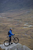 Mountain biking in Arkle, Cape Wrath, Scotland. - Paul Box - 2000s,2005,backpack,backpacks,bag,bags,bicycle,bicycles,BICYCLING,Bicyclist,Bicyclists,bike,bikes,biking,Biking Trail,cape,country,countryside,cycle,cycles,cycling,cyclist,cyclists,helmet,helmets,high