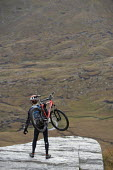 Mountain biking in Arkle, Cape Wrath, Scotland. - Paul Box - 2000s,2005,backpack,backpacks,bag,bags,bicycle,bicycles,BICYCLING,Bicyclist,Bicyclists,bike,bikes,biking,Biking Trail,cape,carries,carry,carrying,country,countryside,cycle,cycles,cycling,cyclist,cycli