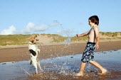 Playing on the beach, Freshwater West Pembrokeshire - Paul Box - ,2000s,2007,animal,animals,bather,bathers,bathing,beach,beaches,boy,boys,canine,catch,catching,child,childhood,children,coast,coastal,coasts,country,countryside,dog,dogs,emilio,holiday,holiday maker,h