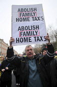 Abolish family Home tax placard at ICTU Jobs Not Debt protest, Dublin, Ireland - Paula Geraghty - Protest,2010s,2013,activist,activists,against,Austerity Cuts,CAMPAIGN,campaigner,campaigners,CAMPAIGNING,CAMPAIGNS,debt,debts,DEMONSTRATING,demonstration,DEMONSTRATIONS,eu,Europe,european,europeans,eu