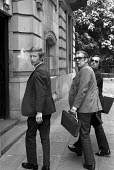 Two private detectives and their lawyer (on right) enter the new National Industrial Relations Court (NIRC) to give evidence against the 5 dockers. They identified the dockers as taking part in unlawf... - Peter Arkell - ,1970s,1972,against,agency,anti union law,anti union laws,anti union legislation,at,CLJ,Court,court case,court courts,court order,criminalisation,criminalise,criminalize,detective,detectives,DISPUTE,d