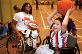Wheelchair basketball star Ade Adepitan at a training session for Haringey school children, including pupils from the Vale School for children with disabilities, during National Inclusion Week. - Philip Wolmuth - 14-11-2002