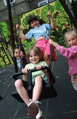Summer playscheme, Camden, London. - Philip Wolmuth - 2000s,2001,CARE,carer,carers,child,Child Care,childcare,CHILDHOOD,CHILDMINDING,children,cities,city,Council Services,Council Services,early years,EDU education,families,FAMILY,female,females,girl,girl