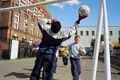 Children playing a game of football at Ashburnham Adventure Playground, Chelsea. London. - Philip Wolmuth - 29-05-2002