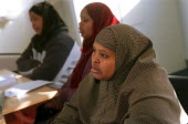 Somali refugees at an English as a Second Language ESOL class run by the College of North West London in the tenants hall on Chalkhill Estate, Wembley, Brent, London. - Philip Wolmuth - 2000,2000s,Adult Education,Asylum Seeker,Asylum Seekers,Asylum Seeker,Asylum Seekers,BAME,BAMEs,Basic Skills,bilingual,Black,BME,bmes,cities,city,College,COLLEGES,communicating,communication,Diaspora,