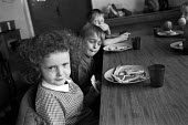 Breakfast club at Hunderton Infants School, Hereford, funded through the Education Action Zone programme. - Philip Wolmuth - 1990s,1999,Breakfast,child,CHILDHOOD,CHILDREN,club,clubs,EDU,educate,educating,Education,educational,EQUALITY,excluded,exclusion,food,FOODS,HARDSHIP,impoverished,impoverishment,INEQUALITY,infancy,INFA