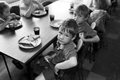 Breakfast club at Hunderton Infants School, Hereford, funded through the Education Action Zone programme. - Philip Wolmuth - 1990s,1999,bread,Breakfast,child,CHILDHOOD,CHILDREN,club,clubs,EDU,EDU education,educate,educating,Education,educational,EQUALITY,excluded,exclusion,food,FOODS,HARDSHIP,impoverished,impoverishment,INE