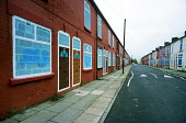 Terraced street of empty houses in Liverpool 8 with doors painted on them. The city council plans to demolish 6000 properties suffering from low demand. - Philip Wolmuth - 27-10-2000