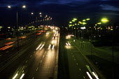 Traffic on the North Circular Road in north west London - Philip Wolmuth - 2000s,2002,at,AUTO,AUTOMOBILE,AUTOMOBILES,AUTOMOTIVE,busy,car,carrageway,cars,cities,city,dual,EBF economy,ENI environmental issues,fast,highway,light,lighting,London,movement,night,road,ROADS,speed,s
