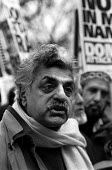 Tariq Ali speaks to a TV crew, Stop the War Coalition demonstration, Piccadilly, London - Philip Wolmuth - 2000s,2003,activist,activists,against,anti war,Antiwar,Asian,asians,BAME,BAMEs,black,BME,bmes,CAMPAIGN,campaigner,campaigners,CAMPAIGNING,CAMPAIGNS,Coalition,crew,DEMONSTRATING,demonstration,DEMONSTRA