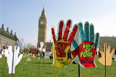 Part of a field of 2500 hands planted in Parliament Square by Hands Up For Peace, an anti-war campaign set up by school pupils to protest at the war on Iraq - Philip Wolmuth - ,2000s,2003,activist,activists,anti war,Antiwar,CAMPAIGN,campaigner,campaigners,CAMPAIGNING,CAMPAIGNS,child,CHILDHOOD,children,coalition,DEMONSTRATING,DEMONSTRATION,DEMONSTRATIONS,hands,Iraq,juvenile,