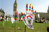 Part of a field of 2500 hands planted in Parliament Square by Hands Up For Peace, an anti-war campaign set up by school pupils to protest at the war on Iraq - Philip Wolmuth - 2000s,2003,activist,activists,anti war,Antiwar,CAMPAIGNING,CAMPAIGNS,child,CHILDHOOD,children,coalition,DEMONSTRATING,demonstration,hands,Iraq,juvenile,juveniles,kid,kids,pacifism,Parliament,peace,peo