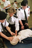 Teenage police cadets are trained in First Aid - Philip Wolmuth - 2000s,2002,adolescence,adolescent,adolescents,adult,adults,CADET,cadets,CLJ law,emergency,FEMALE,force,HEA health,MATURE,OFFICER,OFFICERS,people,person,persons,police,policewoman,policewomen,policing,