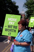 Equal Pay. Domestic Peri Alta on the picket line at Whipps Cross Hospital. She has worked at the hospital for two and a half years and takes home �280 per fortnight. The campaign for a living wage by... - Philip Wolmuth - 28-05-2003