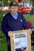 Senior Porter Trevor Wilson on the picket line at Whipps Cross Hospital. He has worked at the hospital for 24 years and takes home �321 per fortnight. The campaign for a living wage by contract cateri... - Philip Wolmuth - 28-05-2003