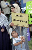 Equal Pay. Contract catering, portering and cleaning staff employed by multinational ISS Mediclean picket Whipps Cross Hospital over pay and conditions. Their campaign for a living wage is backed by U... - Philip Wolmuth - 28-05-2003