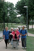 Healthy Walking Group led by Tower Hamlets Council Walking Officer Marc Malone on a one and a half mile route through Mile End Park, London. - Philip Wolmuth - 10-06-2003