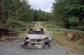 Burnt out car dumped on forestry land above Tan-y-Bwlch, North Wales - Philip Wolmuth - 10-08-2003