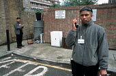 Bethnal Green Neighbourhood Wardens Sheikh Nanumiah and Doraj Miiah radio in to Tower Hamlets street cleansing department to report illegally dumped rubbish. London - Philip Wolmuth - 19-05-2003