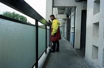 Bethnal Green Neighbourhood Warden Mohibur Rahman patrols Collingwood Estate, Tower Hamlets. London. - Philip Wolmuth - 19-05-2003
