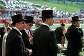 Racegoers watch the horses in front of The Queen's Stand at Epsom Downs racecourse on Derby Day - Philip Wolmuth - 2000s,2001,AFFLUENCE,AFFLUENT,bet,BETS,betting,Bourgeoisie,cities,city,class,Derby,Domesticated Ungulates,elite,elitism,EQUALITY,equestrian,equine,flat,gamble,gambler,gambling,hat,hats,high,high incom