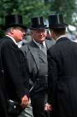 Racegoers in the Paddock at Epsom Downs racecourse on Derby Day. - Philip Wolmuth - 2000s,2003,AFFLUENCE,AFFLUENT,Bourgeoisie,cigar,cities,city,class,Derby,Domesticated Ungulates,elite,elitism,EQUALITY,equestrian,equine,flat,hat,hats,high,high income,horse,horses,income,INCOMES,INEQU