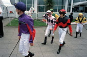 Jockeys walk to the Paddock before a race at Epsom Downs racecourse on Derby Day. - Philip Wolmuth - 07-06-2003