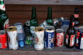 Empty bottles and cans at Epsom Downs racecourse, Derby Day, London - Philip Wolmuth - 09-06-2001