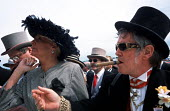 Racegoers place bets in front of The Queen's Stand at Epsom Downs racecourse on Derby Day - Philip Wolmuth - 09-06-2001