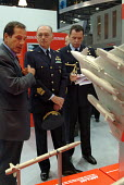 Italian military personnel at the MBDA Missile Systems stand at the Defence Systems and Equipment International Exhibition, Docklands, London 9/9/03. - Philip Wolmuth - 2000s,2003,armaments,armed forces,arms fair,arms selling,arms trade,army,capitalism,capitalist,cities,city,dealer,DEALERS,dealing,defence,defense,DSEi,EBF economy,EXCel,Exhibition,export,EXPORTS,Indus