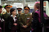 A Chinese Army Lieutenant General inspects a vehicle at the Smiths Aerospace stand at the Defence Systems and Equipment International Exhibition, Docklands, London 9/9/03. - Philip Wolmuth - 2000s,2003,Aerospace,armaments,arms fair,arms selling,arms trade,army,capitalism,capitalist,China,Chinese,cities,city,dealer,DEALERS,dealing,defence,defense,DSEi,EBF economy,EXCel,Exhibition,export,EX