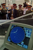 A Chinese Army delegation inspects equipment on the Kelvin Hughes stand at the Defence Systems and Equipment International Exhibition, Docklands, London 9/9/03. - Philip Wolmuth - ,2000s,2003,armaments,arms fair,arms selling,arms trade,army,capitalism,capitalist,China,Chinese,cities,city,dealer,DEALERS,dealing,defence,defense,DSEi,EBF Economy,equipment,EXCel,Exhibition,export,E