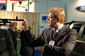 Czech Ambassador Stefan Fule inspects a vehicle-mounted machine gun on the Land Rover stand at the Defence Systems and Equipment International Exhibition, Docklands, London 9/9/03. - Philip Wolmuth - 09-09-2003