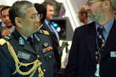 A Malaysian Army Brigadier General inspects the Flexible Battlefield Command and Information Systems stand at the Defence Systems and Equipment International Exhibition, Docklands, London 9/9/03. - Philip Wolmuth - 2000s,2003,armaments,arms fair,arms selling,arms trade,army,capitalism,capitalist,cities,city,dealer,DEALERS,dealing,defence,defense,DSEi,EBF economy,EXCel,Exhibition,export,EXPORTS,human rights,Indus