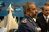 Qatar Brigadier at the BAE Systems stand at the Defence Systems and Equipment International Exhibition, Docklands, London 9/9/03. - Philip Wolmuth - 2000s,2003,Air force,airforce,armaments,armed forces,arms,arms fair,arms industry,arms selling,arms trade,army,BAE,capitalism,capitalist,cities,city,dealer,DEALERS,dealing,defence,defense,DSEi,EBF eco