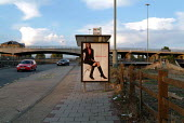 Fashion advertisement on a bus stop in wasteland by the side of the North Circular Road in West London - Philip Wolmuth - 15-09-2003