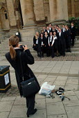 First year students at Oxford pose for photographs after matriculation, the ceremony which marks their formal induction as members of the university. - Philip Wolmuth - 18-10-2003