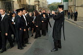 First year students at Oxford pose for photographs before matriculation, the ceremony which marks their formal induction as members of the university. - Philip Wolmuth - 18-10-2003