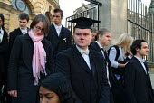 First year students at Oxford, some wearing gold ribbons in protest at tuition fees, leave the Sheldonian Theatre after matriculation, the ceremony which marks their formal induction as members of the... - Philip Wolmuth - 18-10-2003