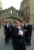 A don waits with first year students at Oxford outside the Sheldonian Theatre before matriculation, the ceremony which marks their formal induction as members of the university. - Philip Wolmuth - 18-10-2003