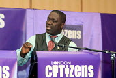 Daniel Atakora, Mile End Hospital UNISON steward, speaks on behalf of the Living Wage Campaign at the first London Citizens Delegates Assembly, organised by TELCO - Philip Wolmuth - 12-02-2004