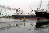 A dock worker checks the mooring ropes of a ship anchored at Immingham Dock on the River Humber. - Philip Wolmuth - 02-04-2004